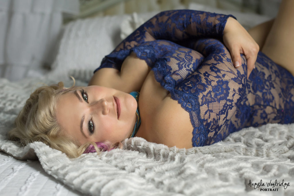 woman on bed in boudoir photography session