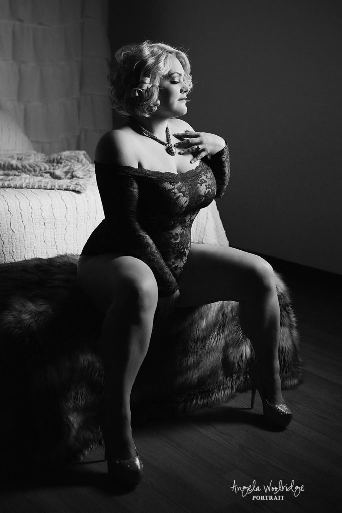 moody black and white of woman in boudoir photography session