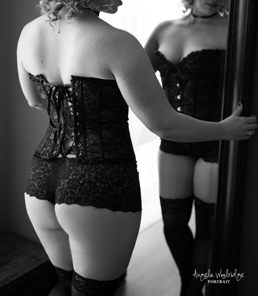 Columbus boudoir photography, woman in corset in front of mirror